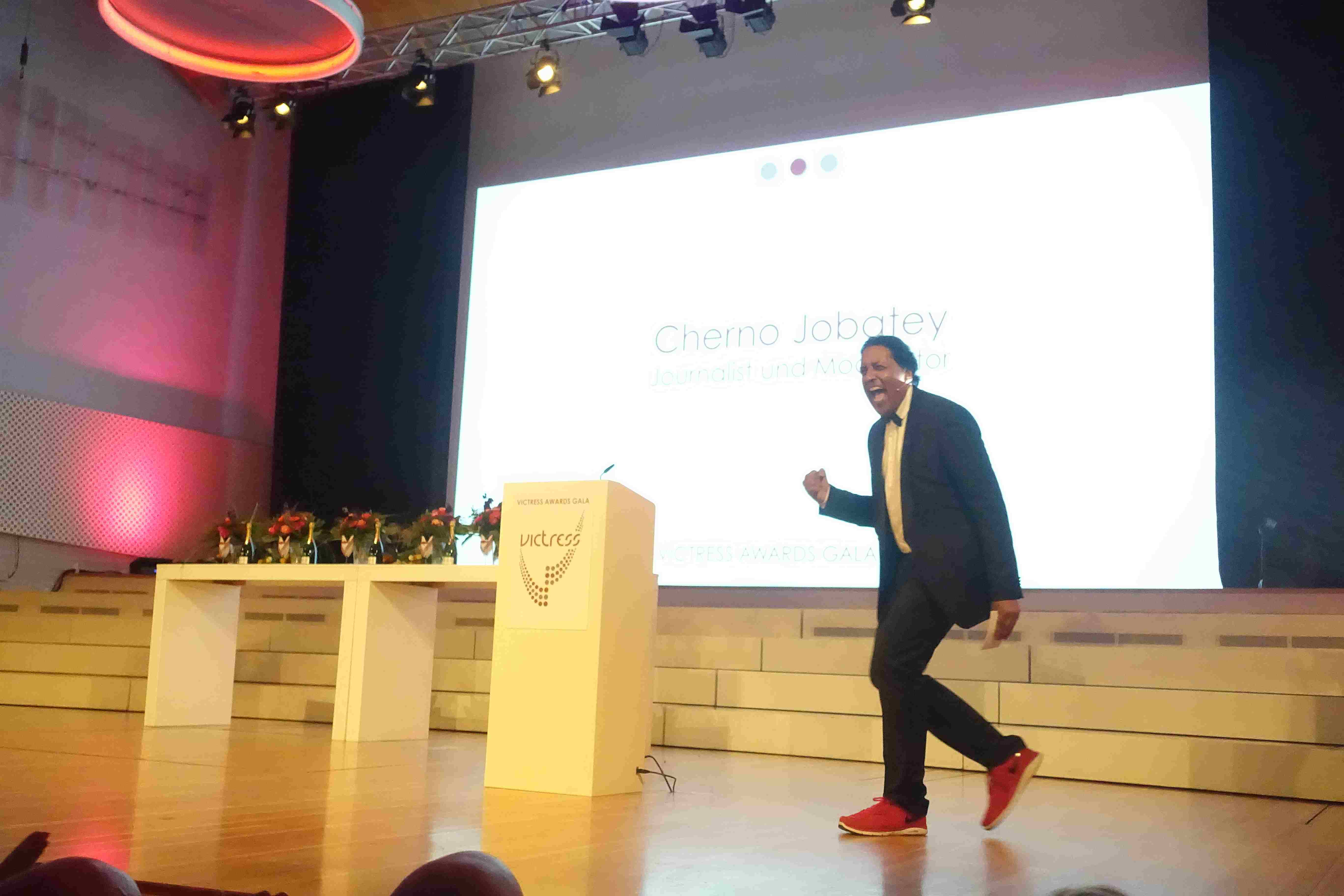 Cherno Jobatey screams on stage